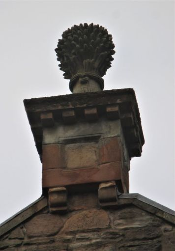 Carvings on the mill's roof
